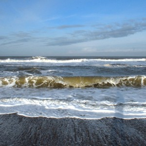 Crashing waves on salthouse beach