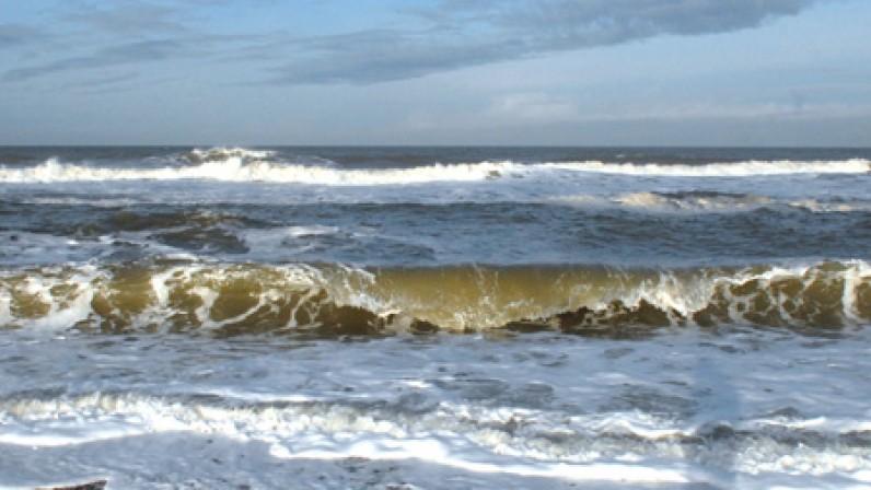 Crashing waves on salthouse beach